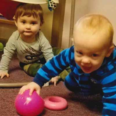 toddlers playing with a ball in a daycare